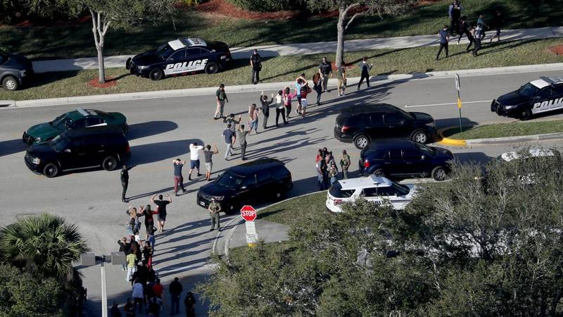 Police evacuate students from Marjory Stoneman Douglas High School in Parkland after a shooting on Feb. 14, 2018.