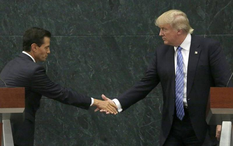 GRIEVOUS GOVERNANCE: Mexican President Enrique Pena Nieto (left) and US President Donald Trump during an awkward handshake in Mexico City in 2016.