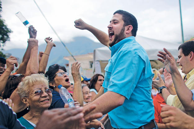 Then Caracas borough mayor David Smolansky rallying anti-Maduro Venezuelans before his escape from Venezuela last year.