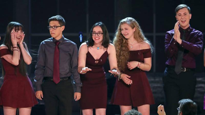 """Students from the Marjory Stoneman Douglas High School drama department react after performing """"Seasons of Love"""" at the 72nd annual Tony Awards at Radio City Music Hall on Sunday, June 10, 2018, in New York."""