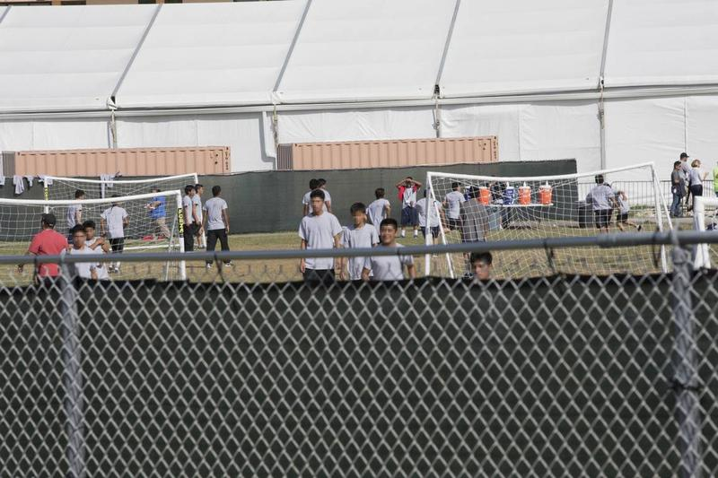 Children play soccer outside of a facility holding unaccompanied and separated children in Homestead.