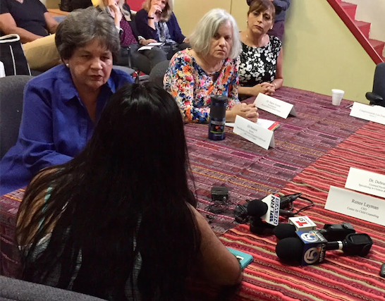 LONG TERM CONSEQUENCES: Florida Congresswoman Lois Frankel (left) listens to an undocumented Guatemalan woman as child psychology experts look on in Lake Worth this month.