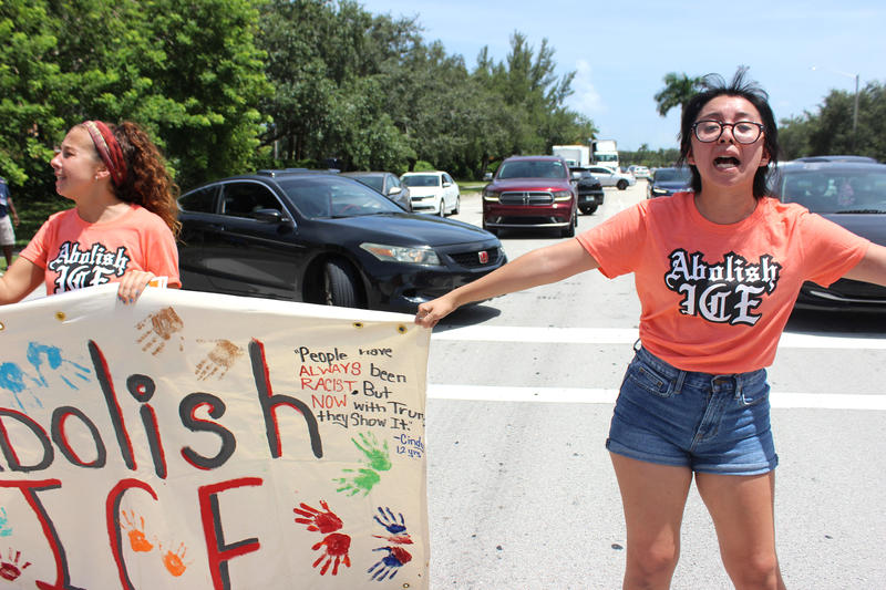 Protesters blocked the intersection of Southwest 145th Avenue and Southwest near the U.S. Immigration and Customs Enforcement field office in Miramar on Wednesday, July 18, 2018. They called for the ICE Field Office to be shut down.