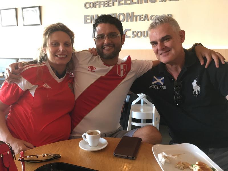 Russia fans Ekaterina Vagin, Edgar Huaitalla, and Lyell Duncan watching the Russia-Croatia match at Granier Bakery.