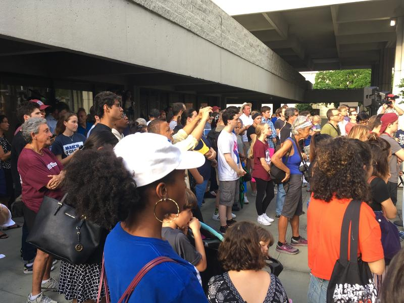 Rally-goers listening to activists speak outside the Ft. Lauderdale federal courthouse.