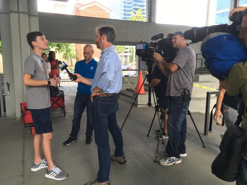 MSD student activisit speaking to television crews outside the Ft. Lauderdale federal courthouse.