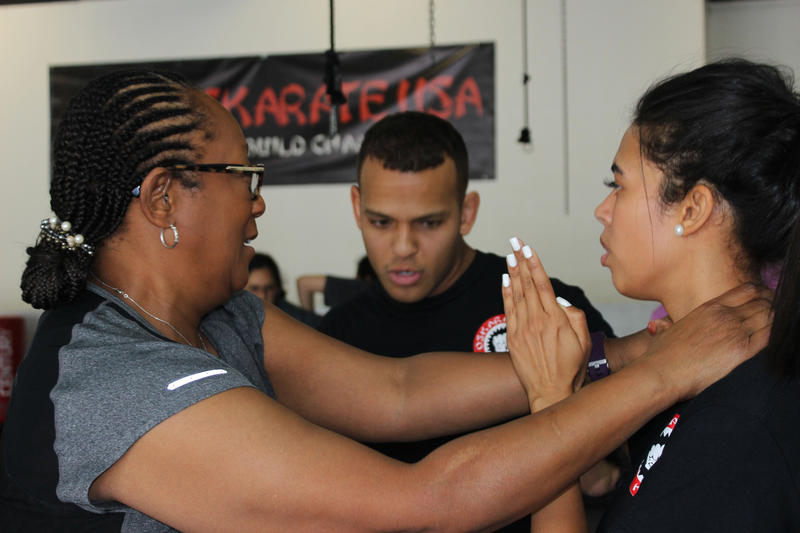Yessenia Urena practices Brazilian Jiu-Jitsu with class member Terri Rose in West Palm Beach's Oskarate USA. Urena provides these free self-defense classes under her nonprofit, End Rape Culture.