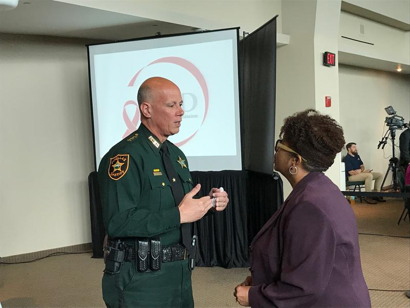 Pinellas County Sheriff Bob Gualtieri (left), the chair of the Public Safety Commission, speaks with Broward County administrator Bertha Henry on Thursday.
