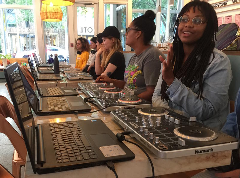 """The women enrolled in the Wednesday Djing class, Girls Can Spin 2, become acquainted with their turntables and the software, Serato, on the first day of class in June. They met for seven more weeks to finish a final mix showcased at a """"graduation"""" party."""