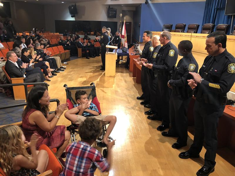 The class is the first to be sworn in since the state Legislature passed a new law requiring a cop on every campus, as a result of the shooting at Marjory Stoneman Douglas High School.