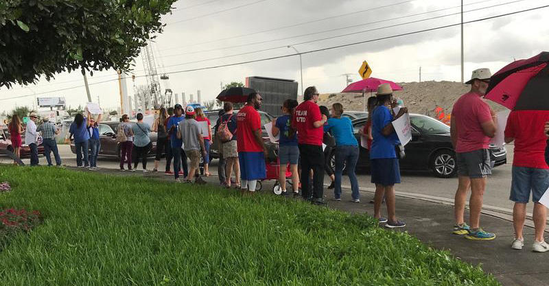 Miami teachers protested in the rain across from Hialeah Gardens city hall earlier this month, denouncing a new law that could threaten the existence of teachers' unions.