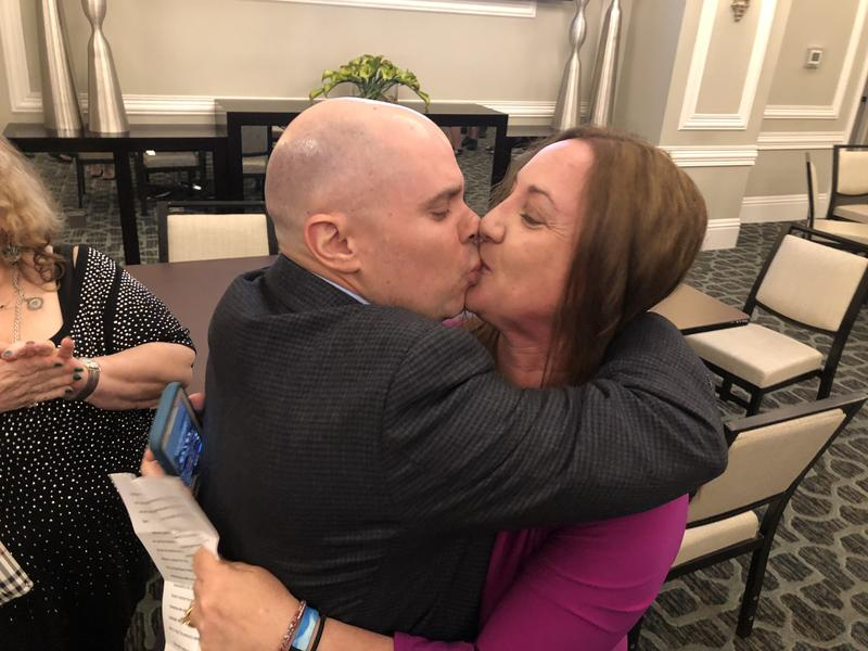 Lori Alhadeff kisses her husband, Ilan, after learning she won a seat on the Broward County school board.
