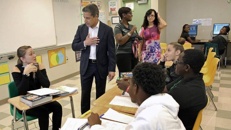 Miami-Dade Superintendent Alberto Carvalho speaks with Dr. Nelmay Silva, who teaches a class on intensive reading at Miami Jackson Senior High School on the first day back to school after Hurricane Irma on Monday, September 18, 2017.