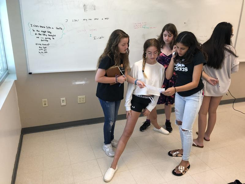 Participants in a songwriting class work together to write lyrics and a melody. They start a new school year at Marjory Stoneman Douglas High School this week.