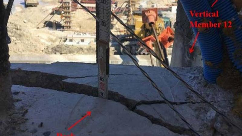 A measuring stick shows the depth of a crack in the deck of the doomed FIU bridge. This photo was dated March 13, 2018, two days before the bridge collapsed, killing six.