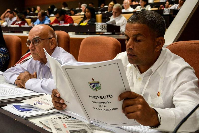 A member of Cuba's National Assembly studies proposed changes to the island's Constitution this summer.