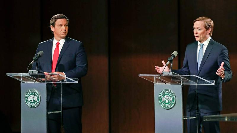 The Republican candidates for governor debated in Jacksonville on Wednesday, Aug. 8, 2018. Ron DeSantis, left, listens as Adam Putnam makes a statement.