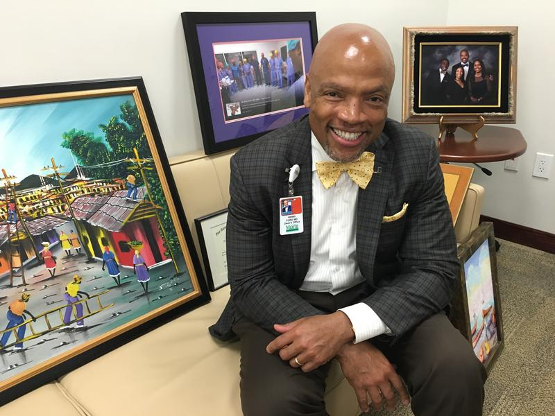 Dr. Henri Ford is the new dean at the University of Miami Miller School of Medicine. His diplomas and art were waiting to be hung in his new office.