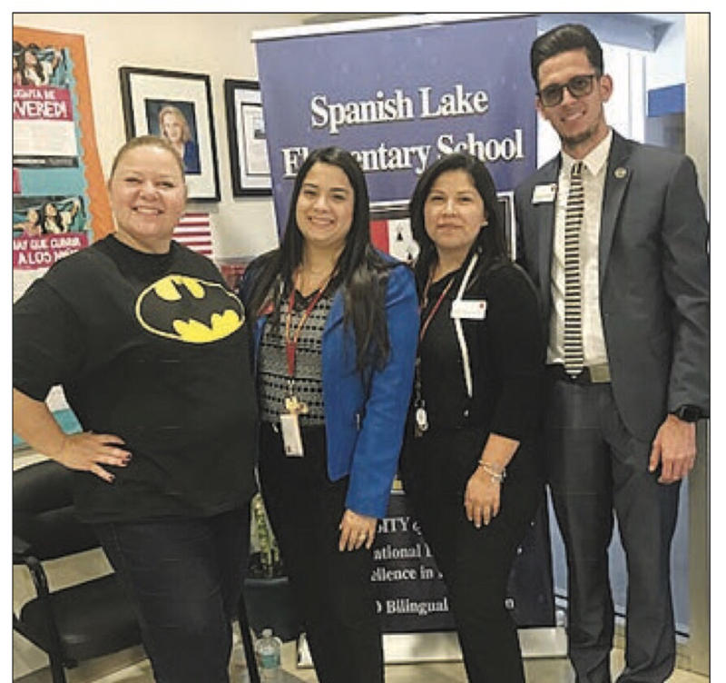 Spanish Lakes Elementary principal Jaquiline Arias-Gonzalez (left) with Teach-A-Thon participants Jessica Saavedra, Luisa Uribe, and Hector Rodriguez.