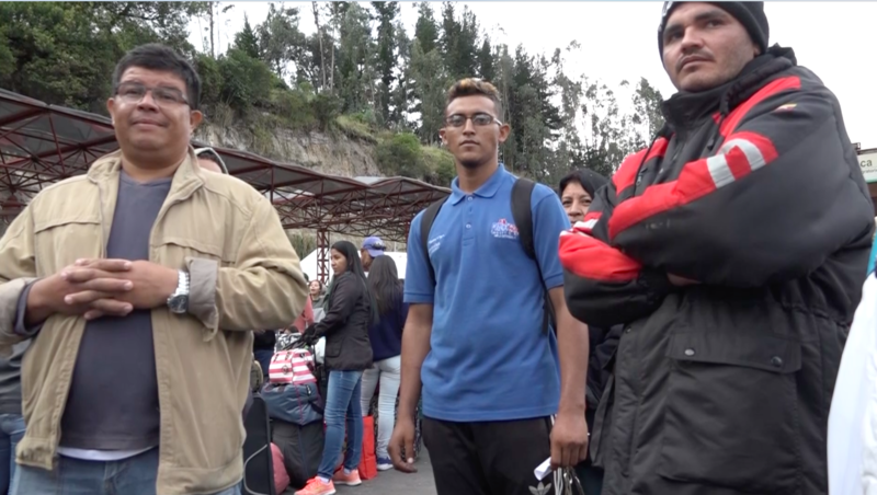 Venezuelan migrant Jose Molleja (center) with other frustrated Venezuelan refugees last week at the mountainous Colombia-Ecuador border crossing of Rumichaca.
