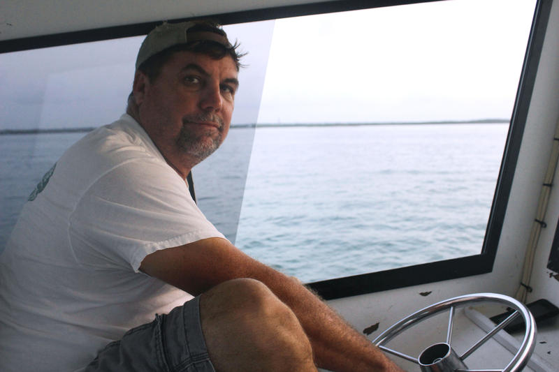 Commercial lobster fisherman Ernie Piton steers the boat for his family-run company, Risky Business II, on Thursday, Aug. 9, 2018.