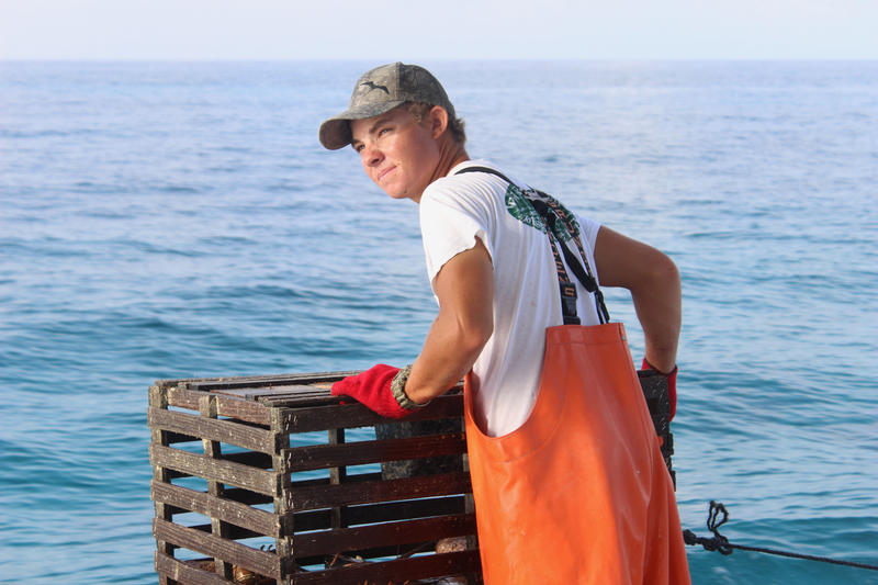 Travis Piton works on his father's lobster boat in Key Largo on Thursday, Aug. 9, 2018. The family-run operation is called Risky Business II.