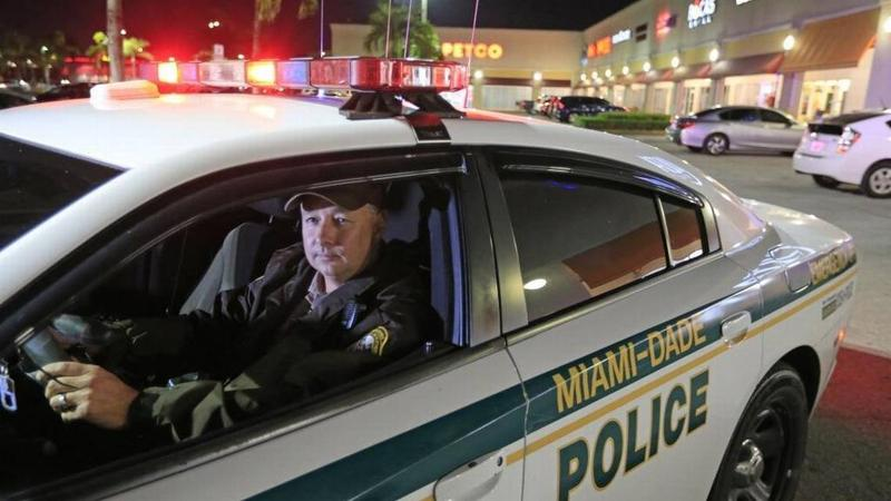 Miami Dade Police Officer Kenny Bonnet patrols in Kendall on Wednesday, Dec. 13, 2017.