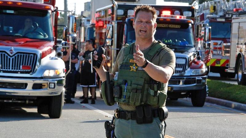 A Broward Sheriff's deputy takes charge of the scene at Marjory Stoneman Douglas High School in Parkland on Wednesday, Feb. 14, 2017, on the day Nikolas Cruz fatally shot 17 students and staffers.