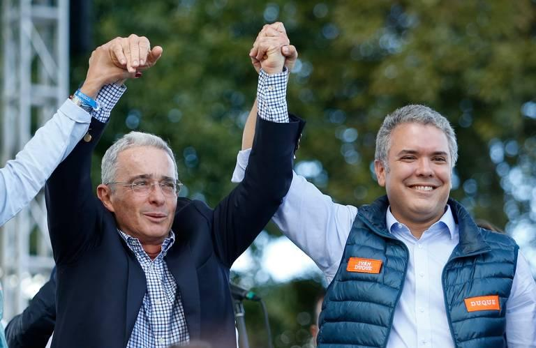 PLIABLE PROTEGE? Colombian President-elect Ivan Duque (right) on the campaign trail with former President Alvaro Uribe in May.