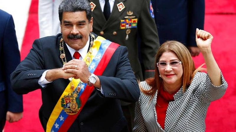 In this May 24, 2018, file photo, Venezuela's President Nicolas Maduro, left, and first lady Cilia Flores, acknowledge the press corps as they arrive for a session with the Constituent Assembly, in Caracas, Venezuela.