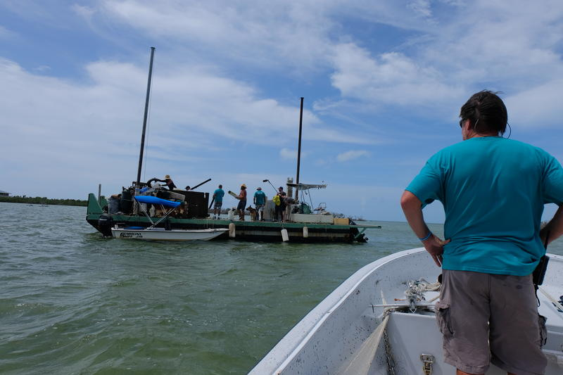 Brian Vest, founder of the Conch Republic Marine Army, checks on the barge off Ramrod Key where debris pulled from the shoreline was being collected.