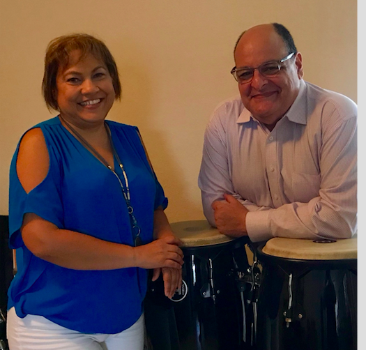 Ernesto Morales (right) and his wife Iris Duprey at their new home in Hialeah with the conga drums he brought from Puerto Rico after Hurricane Maria.