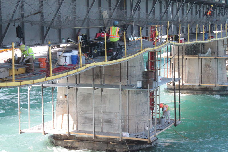 The crews working on the bridge project built a platform underneath the original girder to provide access and limit impact on the seabed beneath the bridge.
