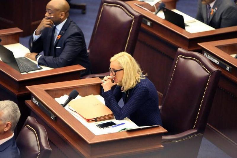 Sen. Lauren Book gets emotional on the floor of the Senate on Feb. 21, 2018, after photos of the 17 victims of the shooting at Marjory Stoneman Douglas High School were shown on a screen overhead. She prizes her position on an investigative commission.