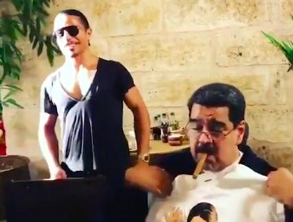 Venezuelan President Nicolas Maduro (right) receiving a T-shirt from celebrity Turkish chef Salt Bae.