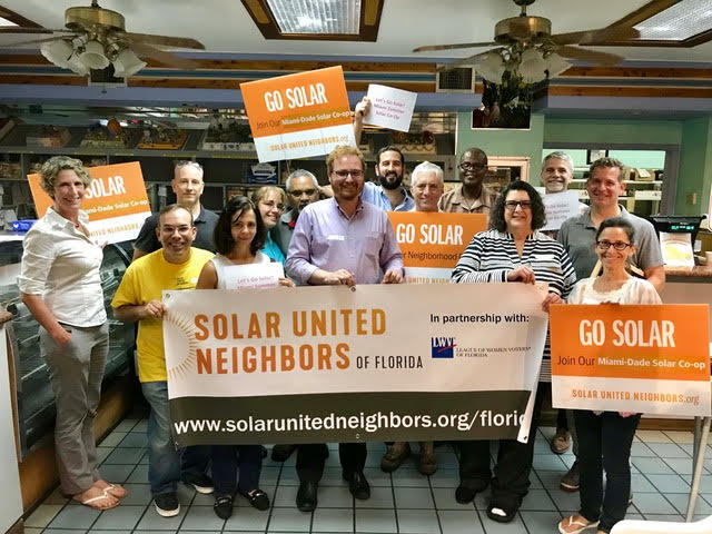 Leaders of the Miami-Dade summer solar co-op pose at El Brazo Fuerte Bakery. The bakery is participating in the co-op, which helps homeowners and businesses get group rates on solar panels.