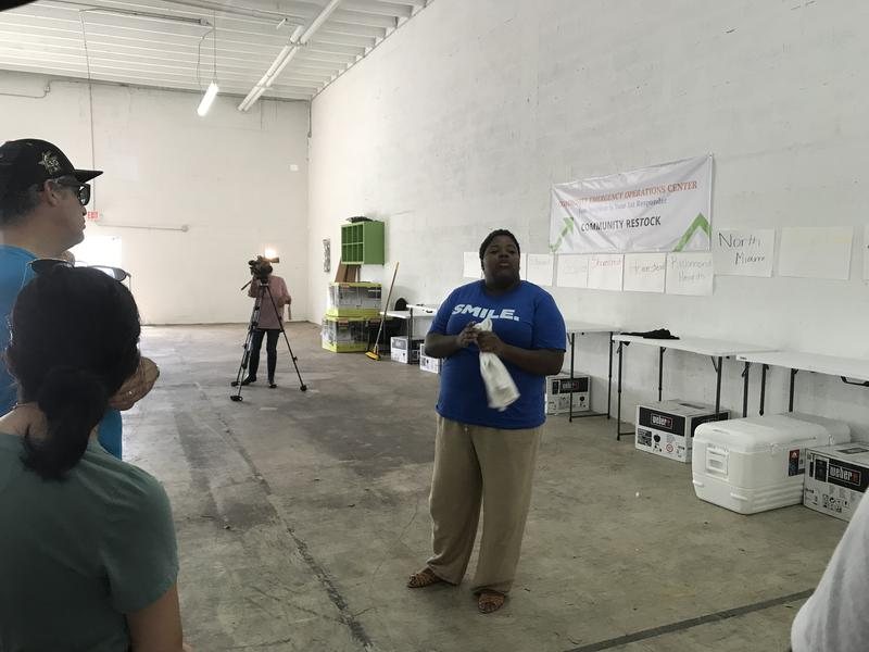 "Valencia Gunder, a Miami-Dade-based community organizer, gives a tour of the warehouse near Opa-Locka that will be used as a ""community emergency operations center"" following a hurricane or other disaster."