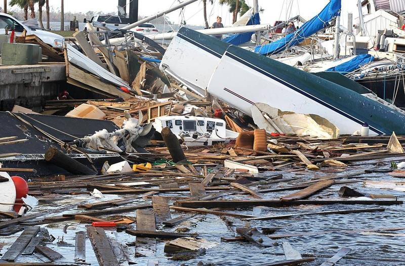 Wrecked boats floated at Panama City's city marina on Thursday.