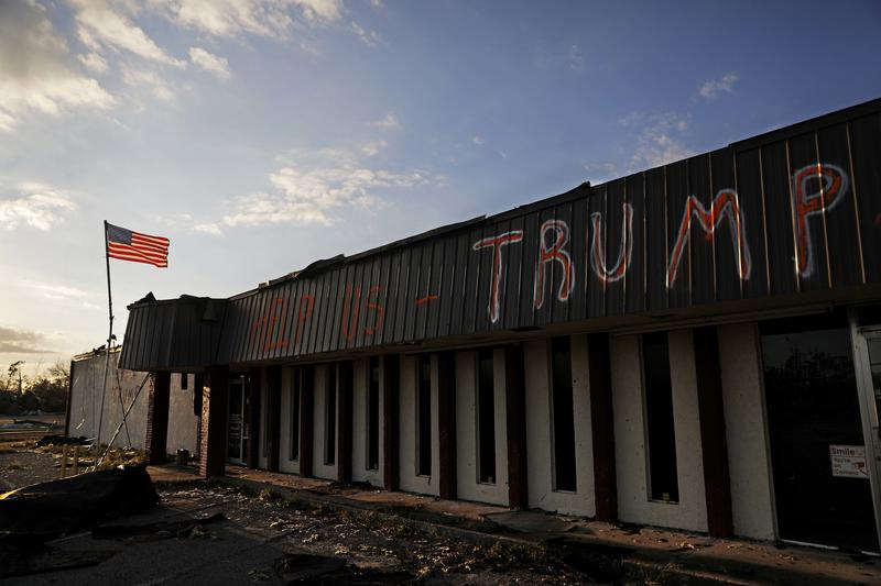 "A message reading ""Help us Trump"" is written on a damaged business from Hurricane Michael in Callaway, Fla., Sunday, Oct. 14, 2018."