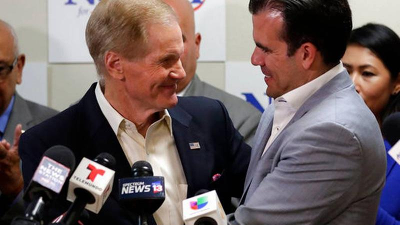U.S. Sen. Bill Nelson, left, is embraced after Puerto Rico Governor Ricardo Rossello, right, endorsed his bid for the senate in front of supporters and media during a news conference Monday Oct. 1, 2018, in Orlando, Fla.