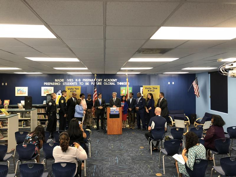 Tony Argiz, chair of a political action committee supporting the teacher pay referendum, begins a news conference at Madie Ives K-8 Center near Aventura on Tuesday morning. Miami-Dade County schools superintendent Alberto Carvalho looks on.