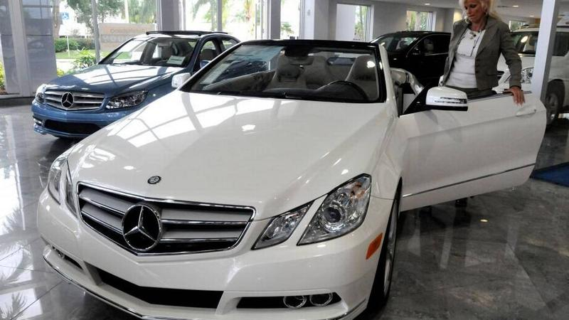 A shopper considers a car at the the Mercedes-Benz dealership at 4250 North State Road 7 in Coconut Creek. A new bullying scholarship is funded by redirecting sales taxes on vehicle purchases.