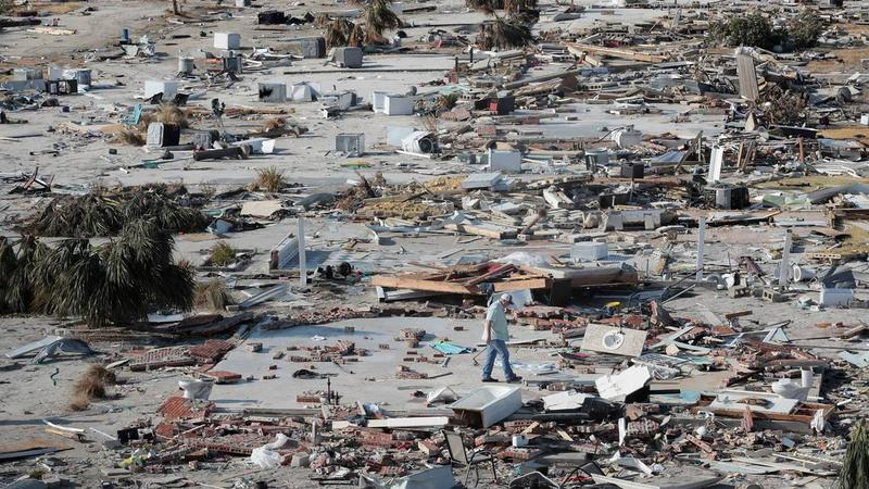 A man walks through a beachfront neighborhood six days after Hurricane Michael made landfall near Mexico Beach, Florida, on Oct. 10 as a Category 4 storm. The neighborhood, with homes lining the beach, is now mostly flattened.