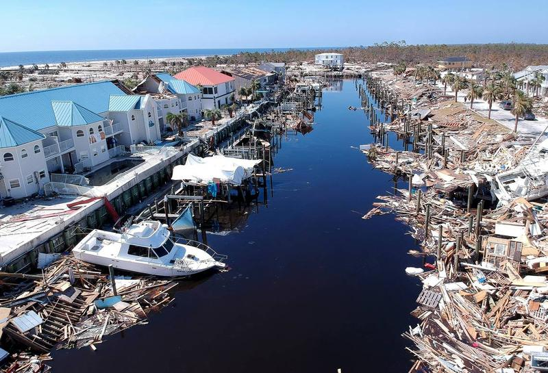 Debris litters a canal in Mexico Beach on Monday October 15, 2018.