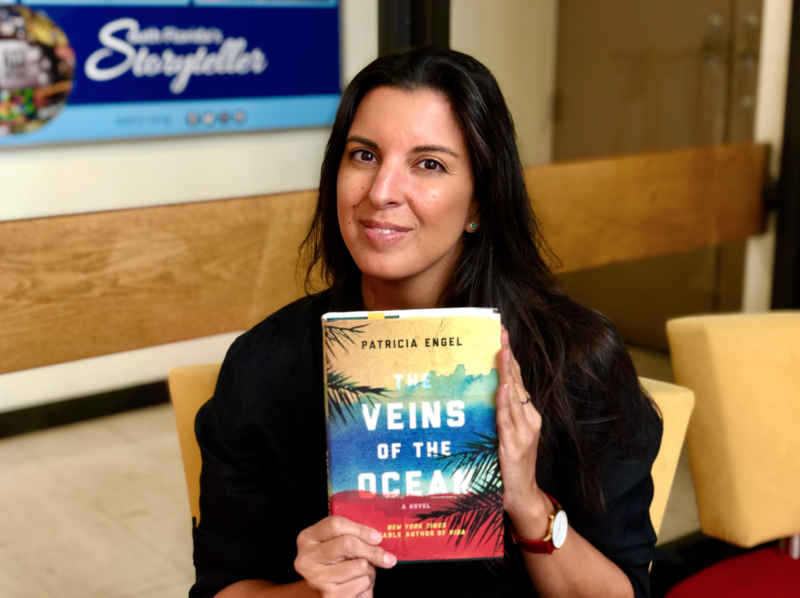 "Patricia Engel holds her 2016 novel and this month's Sundial Book Club read, ""Veins of the Ocean."""