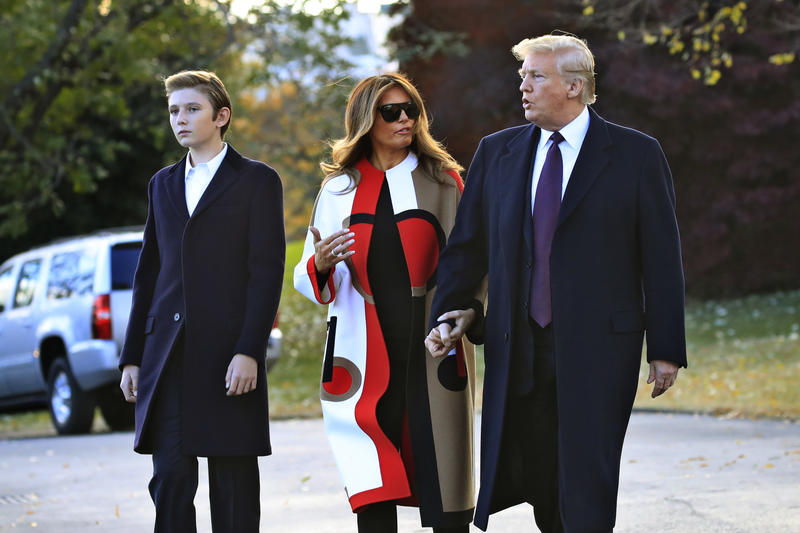 President Donald Trump and first lady Melania Trump with their son Barron Trump talk as they walk on the South Lawn of the White House in Washington, Tuesday, Nov. 20, 2018, to board the Marine One.