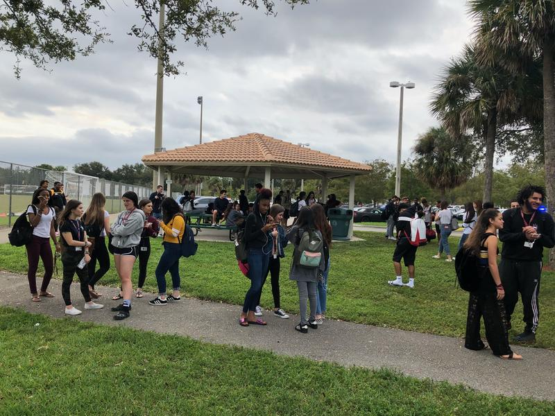 Marjory Stoneman Douglas High School students gathered in a park nearby after walking out of class this morning.