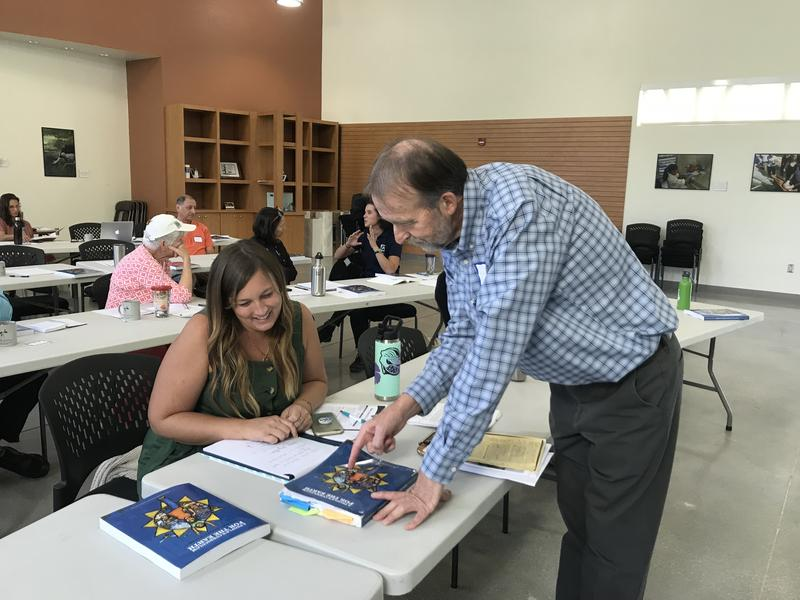 Lauren Chesrown, a a lab science teacher at Jensen Beach Elementary in Martin County, talks with climate change education workshop leader Bill Bigelow.