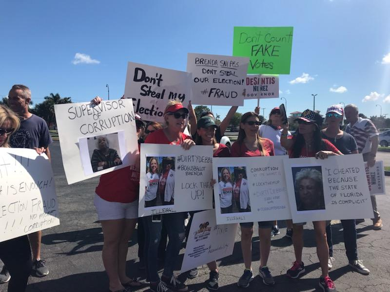 Around a hundred people congregated in front of the office of the Broward County Supervisor of Elections in Lauderhill to protest against Supervisor Brenda Snipes on Friday, Nov. 9, 2018.
