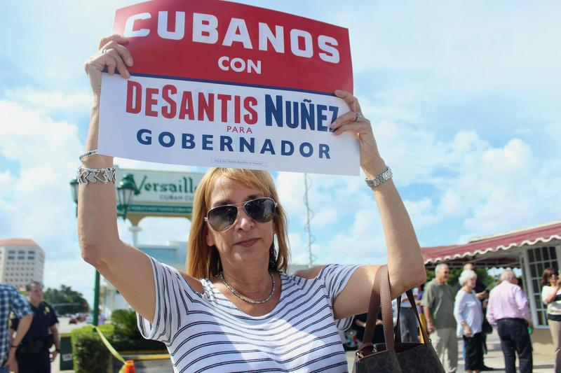 Milly Gonzalez grew up in Miami and escaped Cuba when she was 5-years-old. She supported Republican gubernatorial candidate Ron DeSantis outside Versailles Cuban Bakery on Thursday, Nov. 1, 2018.